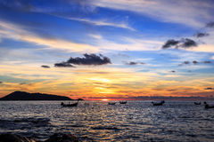 Dramatic Sunset with local boat in Thailand Royalty Free Stock Image