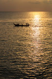 Dramatic Sunset with local boat in Thailand Stock Photo