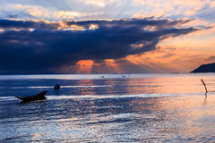 Dramatic Sunset with local boat in Thailand Stock Photography