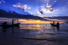 Dramatic Sunset with local boat in Thailand Stock Images