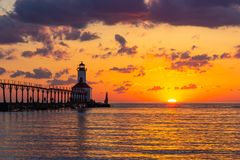 Dramatic Sunset at Michigan City East Pierhead Lighthouse. Stunning sunset with dramatic clouds over Michigan City East Pierhead Lighthouse, Washington Park royalty free stock images