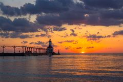 Dramatic Sunset at Michigan City East Pierhead Lighthouse. Stunning sunset with dramatic clouds over Michigan City East Pierhead Lighthouse, Washington Park stock image