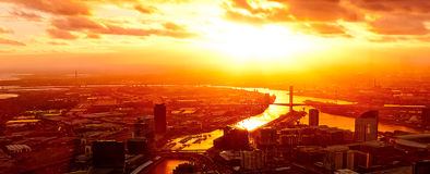 Dramatic sunset on a modern metropolis. End of the world on a futuristic city Royalty Free Stock Images