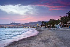 Dramatic sunset near resort hotels in Eilat. The shot was done on the northern beach of Eilat which is a famous resort city in Israel Royalty Free Stock Photo
