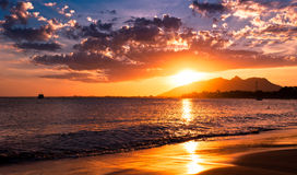 Dramatic Sunset in the Ocean Stock Images