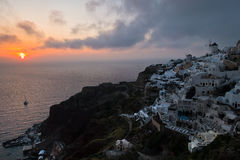 Dramatic sunset in Oia village at Santorini island Royalty Free Stock Images