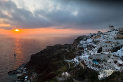 Dramatic sunset in Oia village at Santorini island Royalty Free Stock Photography