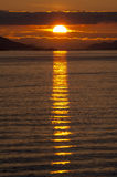 Dramatic sunset over the Arctic coast of Norway Stock Photography