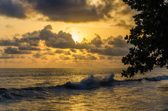 Dramatic sunset over Atlantic ocean with cloudy sky at Limbe, Cameroon, Africa Royalty Free Stock Photo
