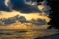 Dramatic sunset over Atlantic ocean with cloudy sky at Limbe, Cameroon, Africa Royalty Free Stock Images