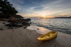 Dramatic sunset over Beach at Lipe Island, Thailand, with kayak stock photos