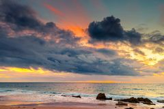 Dramatic sunset over beach Stock Image