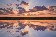 Dramatic sunset over the countryside and the river Royalty Free Stock Image