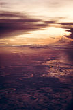 Dramatic sunset over the earth from the height in vintage style with epic sky. Stock Images