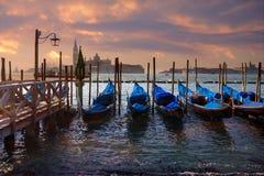 Dramatic sunset over gondola pier Stock Photography