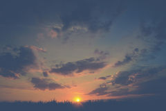 Dramatic sunset over grass Royalty Free Stock Photo