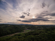 Dramatic sunset over green hills Royalty Free Stock Image