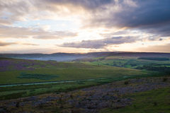 Dramatic sunset over the hills of the Peak District Stock Photo