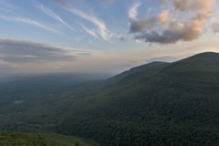 Dramatic Sunset over the Hudson River Valley with Catskill Mountains. Sun setting with the Hudson River Valley in view from Huckleberry Point in the Catskill Stock Photos