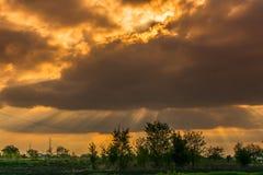 Dramatic sunset over Kikinda. Vojvodina, Serbia. Sunrays visible behind the cloud Stock Image