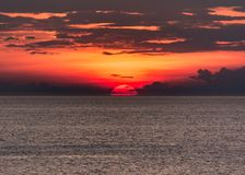Red and beautiful sunset over lake erie. Dramatic sunset over lake erie in summertime cleveland ohio with dramatic clouds Royalty Free Stock Photography