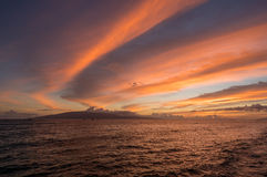 Dramatic sunset over Lanai from Lahaina on Maui. Dramatic sunset behind Lanai off Hawaiian island of Maui. Taken on Front St in resort town of Lahaina Royalty Free Stock Images