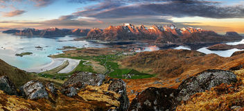 Dramatic sunset over Lofoten mountain Stock Photos