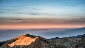 Dramatic sunset over moutain. Cloudy sky at sunset. Sunset in the mountain royalty free stock photo