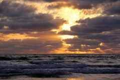 Dramatic Sunset Over Pacific Waves. A spectacular California sunset over Pacific waves Royalty Free Stock Images