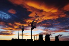 Dramatic orange sunset over coal power plant stock photos