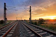 Dramatic sunset over railroad Stock Images
