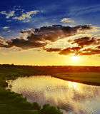 Dramatic sunset over river Royalty Free Stock Photography
