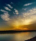 Dramatic sunset over river Royalty Free Stock Image