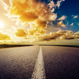 Dramatic sunset over road Stock Images