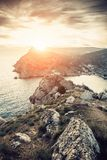Dramatic sunset over rocky mountains at Crimean sea shore. Beautiful nature landscape, summer travel concept.  royalty free stock photography
