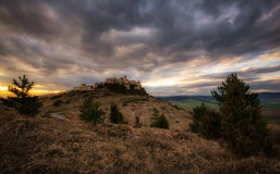 Dramatic sunset over the ruins of Spis Castle in Slovakia. Spis Castle is a national monument and one of the biggest European castles by area royalty free stock photo
