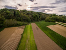 Dramatic sunset over rural area. Photo of dramatic sunset over rural area in spring time shot with drone Royalty Free Stock Photos