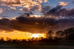 Dramatic sunset over soccer field royalty free stock photography