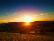 Dramatic sunset over valley. Stock Images