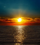 Dramatic sunset over water Royalty Free Stock Image