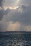 Dramatic sunset on a remote paradisiac island Stock Images