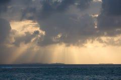 Dramatic sunset on a remote paradisiac island Stock Photos