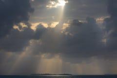 Dramatic sunset on a remote paradisiac island Royalty Free Stock Photo