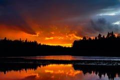 Dramatic sunset on the river Chirko-Kem. Karelia, Russia Stock Photography