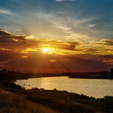 Dramatic sunset and river Stock Images