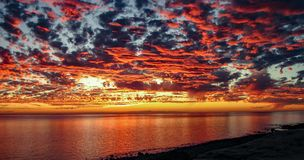 Dramatic Sunset At Rocky Point, Mexico. Dramatic, colorful sunset over Rocky Point Puerto Penasco Mexico looking towards Baja California stock photos