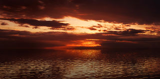 Dramatic sunset in the sea. Panoramic image of dramatic red sunset in the sea Royalty Free Stock Photos