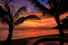 Dramatic Sunset with silhouettes palm in Thailand. Dramatic Sunset with silhouettes palm and reflection in swimming pool Stock Photos