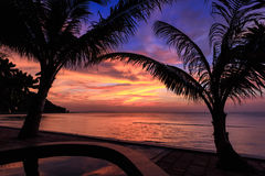 Dramatic Sunset with silhuettes palm in Thailand Royalty Free Stock Image