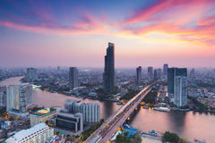 Dramatic after sunset sky, aerial view Bangkok city river curved Stock Photos